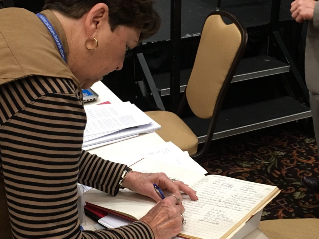 Ruth Waeltz siging the Constitution of the Synod 2018