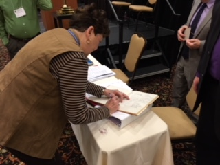 Ruth Waeltz signing the Constitution of the Synod 2018